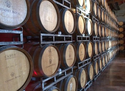 Our wine of our wine of the month club aging in barrels